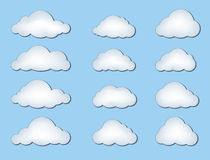 Cloud icon set. Clouds Isolated on Blue Background. Vector Set of Weather Symbols Royalty Free Stock Photo