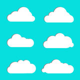 Cloud  icon set white color on blue background. Different nature cloudscape weather symbols. Vector illustration. Cloud  icon set white color on blue background Stock Photography