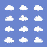Cloud icons. On blue sky. Vector icon set of clouds. Vector illustration Royalty Free Stock Images