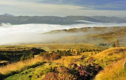 Cloud inversion, loch Tay, Scotland. A view of loch Tay in Scotland, taken from the mountainside of Ben Lawyers, early on a summer morning. Because the loch Royalty Free Stock Photo