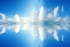 Cloud and its reflection. Beautiful soft white clouds and water reflection Stock Photo