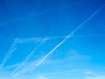 Cloud and jet contrail with blue sky Royalty Free Stock Photo