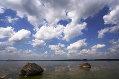 Cloud on the lake. Cloud mirror on the lake with rocks Stock Image