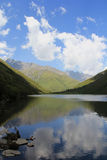 Cloud and lake. A picture of a lake in high mountain Stock Images