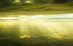 Cloud Layers A1. Amazing sun rays stream between golden cloud layers Stock Image