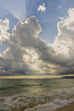 Cloud lighthouse. Sunlight appearing over the clouds after a storm at the beach Stock Photography
