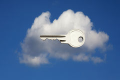 Cloud locked. Photo of key over cloud symbolizing security in cloud applications Royalty Free Stock Image