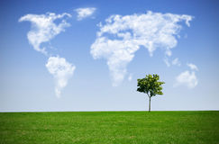 Cloud map world. Clouds in the shape of a world map against blue sky Royalty Free Stock Photos