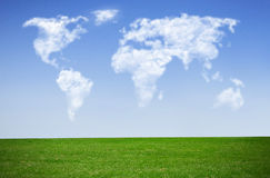 Cloud map world. Clouds in the shape of a world map against blue sky Stock Images