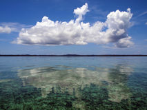 Cloud mirrored in the Caribbean sea Stock Photo