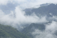 Cloud and mist rising from the valley Stock Images