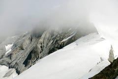 Cloud on Monch peak in Jungfrau region Royalty Free Stock Photography