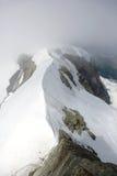 Cloud on Monch peak in Jungfrau region Stock Images