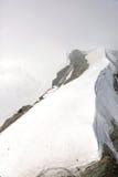 Cloud on Monch peak in Jungfrau region Royalty Free Stock Images