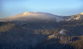 Cloud on mountain top Stock Photo