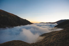 Cloud Between Mountains Royalty Free Stock Images