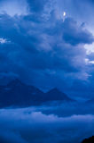 Cloud and mountains at twilight. Clouds rising up the mountains from the valley at dusk Royalty Free Stock Photos