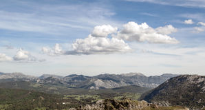Cloud on mountains of Zahara. Mountains of Zahara de la sierra with some trees located in the Spanish province of Cadiz, on a clear day Stock Photo