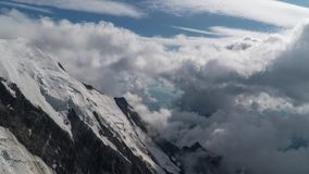 Clouds move overthe European Alps. Cloud movement over the European Alps. View from refuge du Gouter. Time lapse. 4K stock video footage