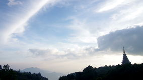 Cloud movement over the pagoda on the mountain range stock video footage