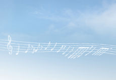 Cloud Music. Music Notes on Blue Clouds Royalty Free Stock Images