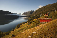 Cloud near the house in the mountains. Cloud near the lonely house in the mountains, Norway stock photo
