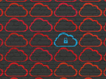 Cloud networking concept: blue cloud icon on wall Royalty Free Stock Photo