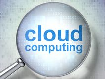 Cloud networking concept: Cloud Computing with optical glass. Cloud networking concept: magnifying optical glass with words Cloud Computing on digital background Stock Photo