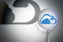 Cloud networking concept:  Cloud with optical glass on digital background. Cloud networking concept: magnifying optical glass with Cloud icon on digital Royalty Free Stock Photo