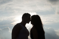 Cloud Nine. Silhouette of a Kiss Against the Clouds Stock Photos