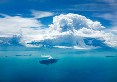 Cloud and ocean with island, aerial view Stock Photo
