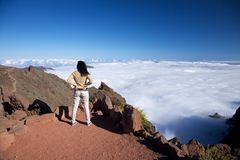 Cloud ocean and woman at La Palma Stock Photo