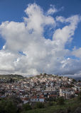 Cloud - octopus above a small provincial Greek town Royalty Free Stock Photo