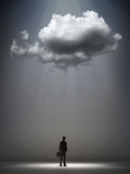 Cloud over a businessman Stock Photography