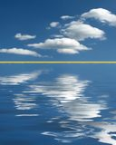 Cloud over calm waters Royalty Free Stock Image
