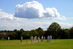 Cloud over cricket match. Cloud over an English village cricket match Royalty Free Stock Image