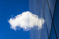 Cloud over skyscraper Stock Images
