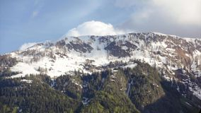 Cloud over snowy mountaintop video stock footage