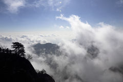 Cloud over the top of the mountain, and has formed a clear skyline Stock Photography