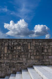 Cloud over the wall. A white cloud in a deep blu sky floars over a wall Stock Photography