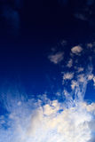 Cloud patern. The sun is lighting very nice cloud in a blue sky Stock Images