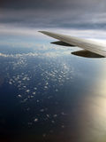 Cloud pattern with Airplane wing Stock Image
