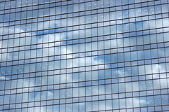 Cloud pattern reflections on modern building Stock Photography