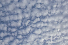 Cloud pattern of sky. Textural patches of clouds in blue sky Stock Photo