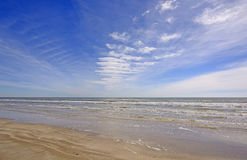 Cloud Patterns over an Ocean Beach Stock Photography