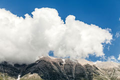 Cloud On Peak Of The Mountain Stock Image