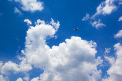 Cloud and plane. A Red plane fly near a Cloud look like an elephant Stock Photo