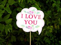 Cloud plate with text I love you. I love you name plate, white cloud, green background, for wedding, marriage nuptials bridal, nuptial, espousal royalty free stock photography