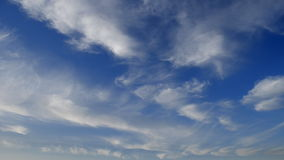 Cloud Plumes in a Blue Sky stock footage