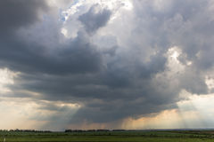 Cloud rain. Summer landscape sky with rain clouds in the sun Royalty Free Stock Photo